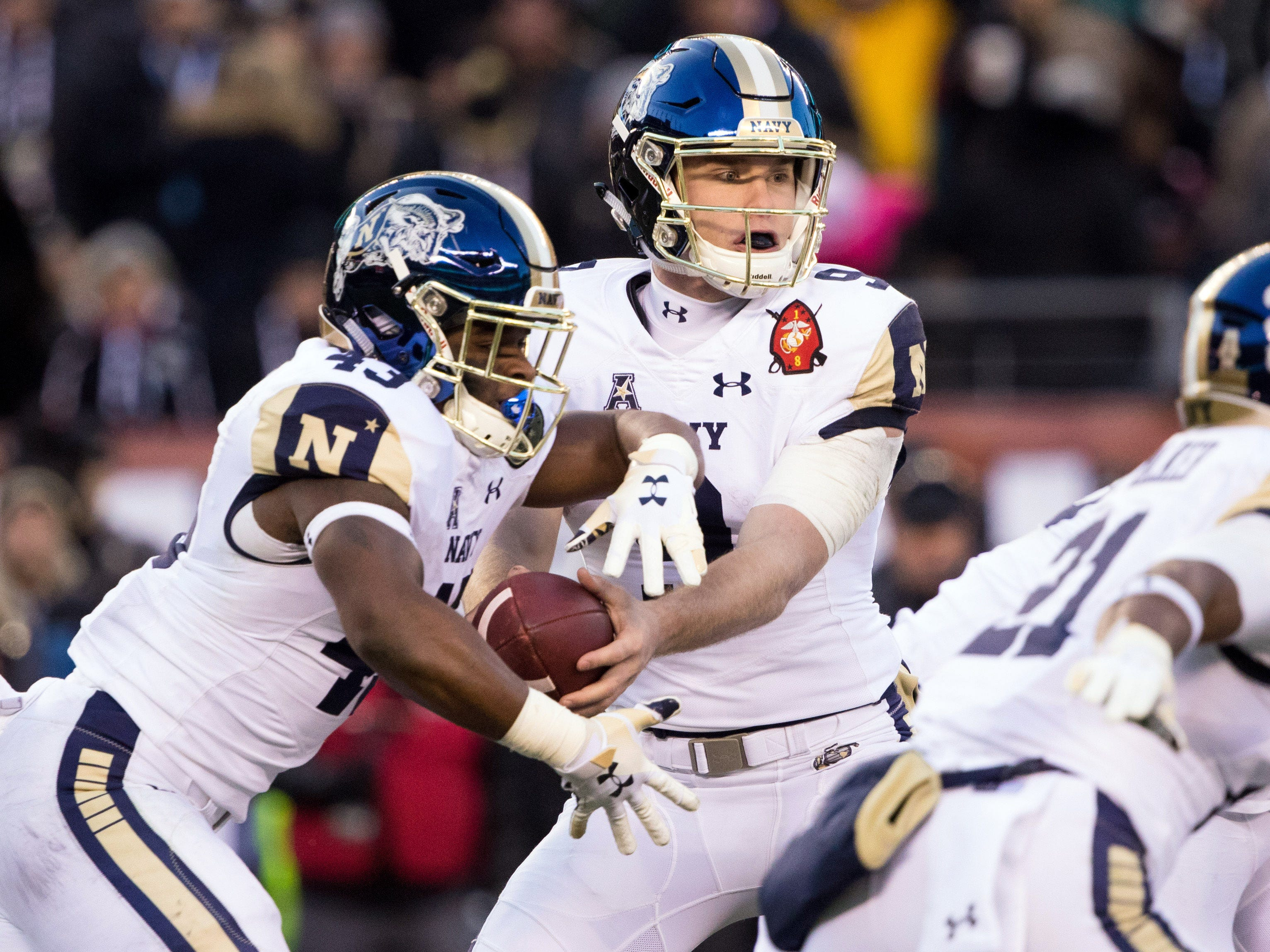 Navy Midshipmen quarterback Zach Abey hands off to fullback Nelson Smith during the second quarter.