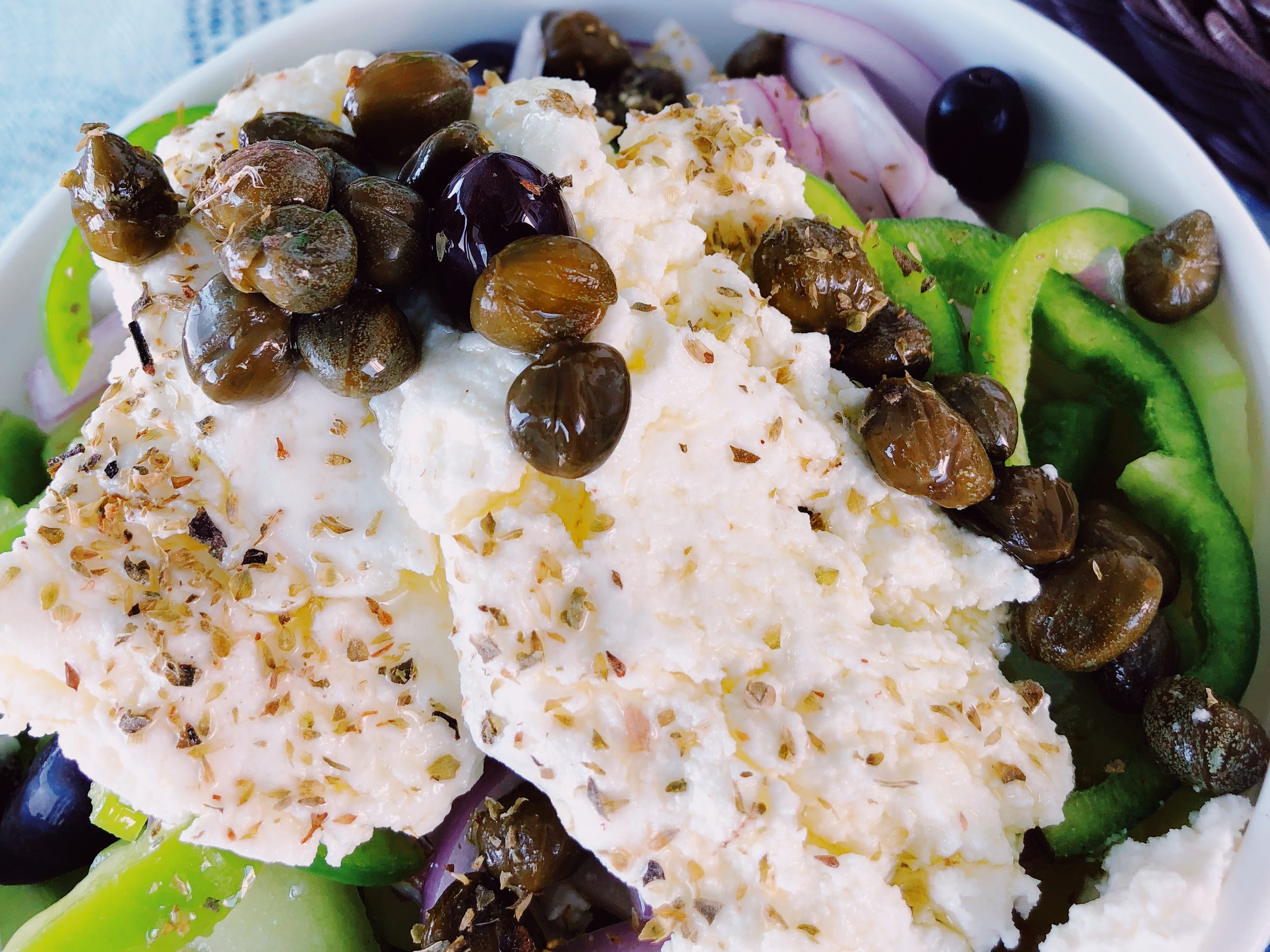 While in most of Greece the classic Greek salad includes feta cheese, on Folegandros and other islands of the Cyclades a much softer sheep or goat cheese called mizithra is used.