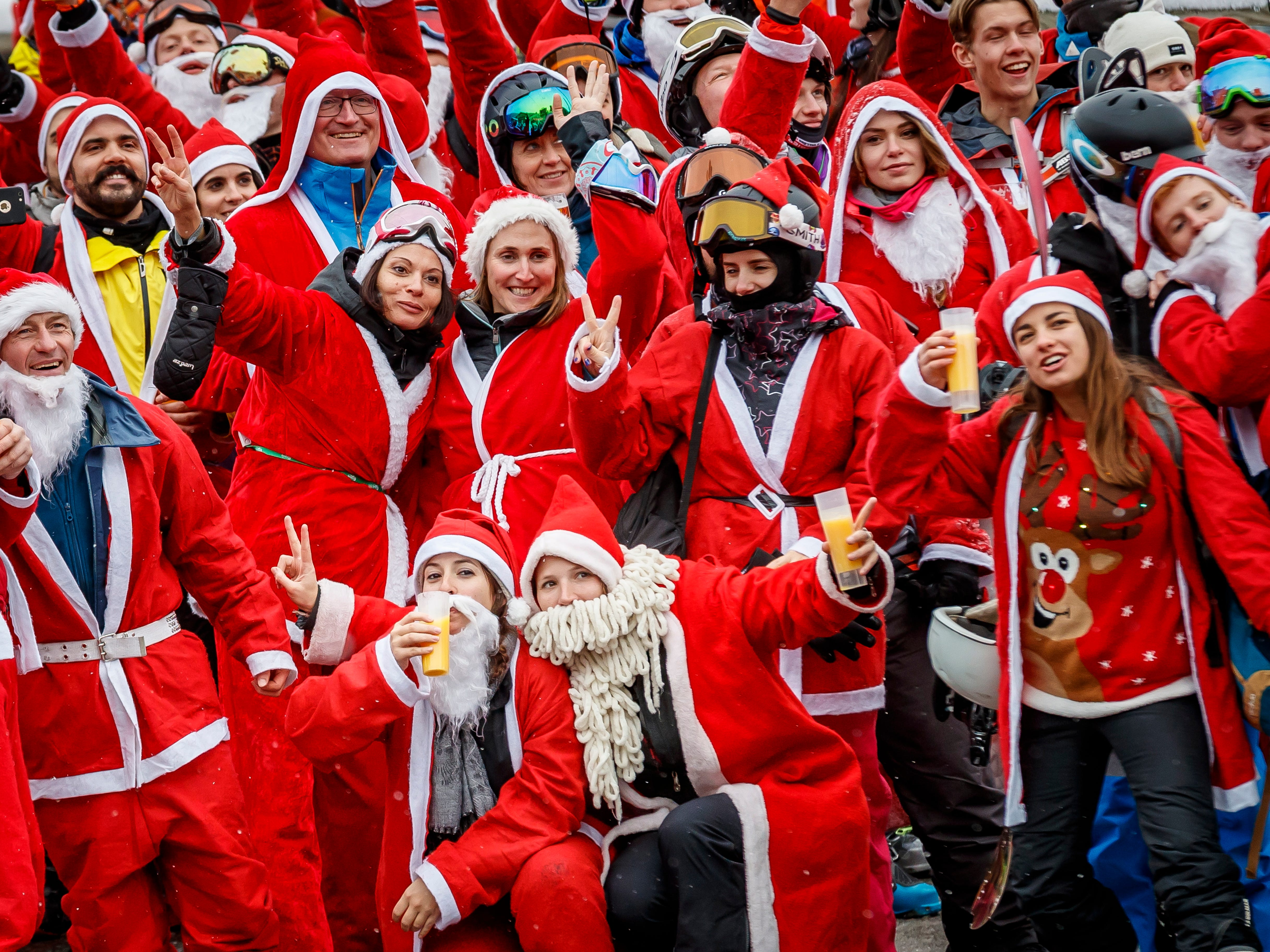 People dressed as Santa Claus gather for a group picture in the alpine ski resort of Verbier, Switzerland on Dec. 8, 2018. 3015 skiers and snow boarders dressed as Santa Claus and Saint Nicholas were granted discounted 5 Swiss franc access pass to the ski resort as a promotional event to celebrate the opening of the ski season.