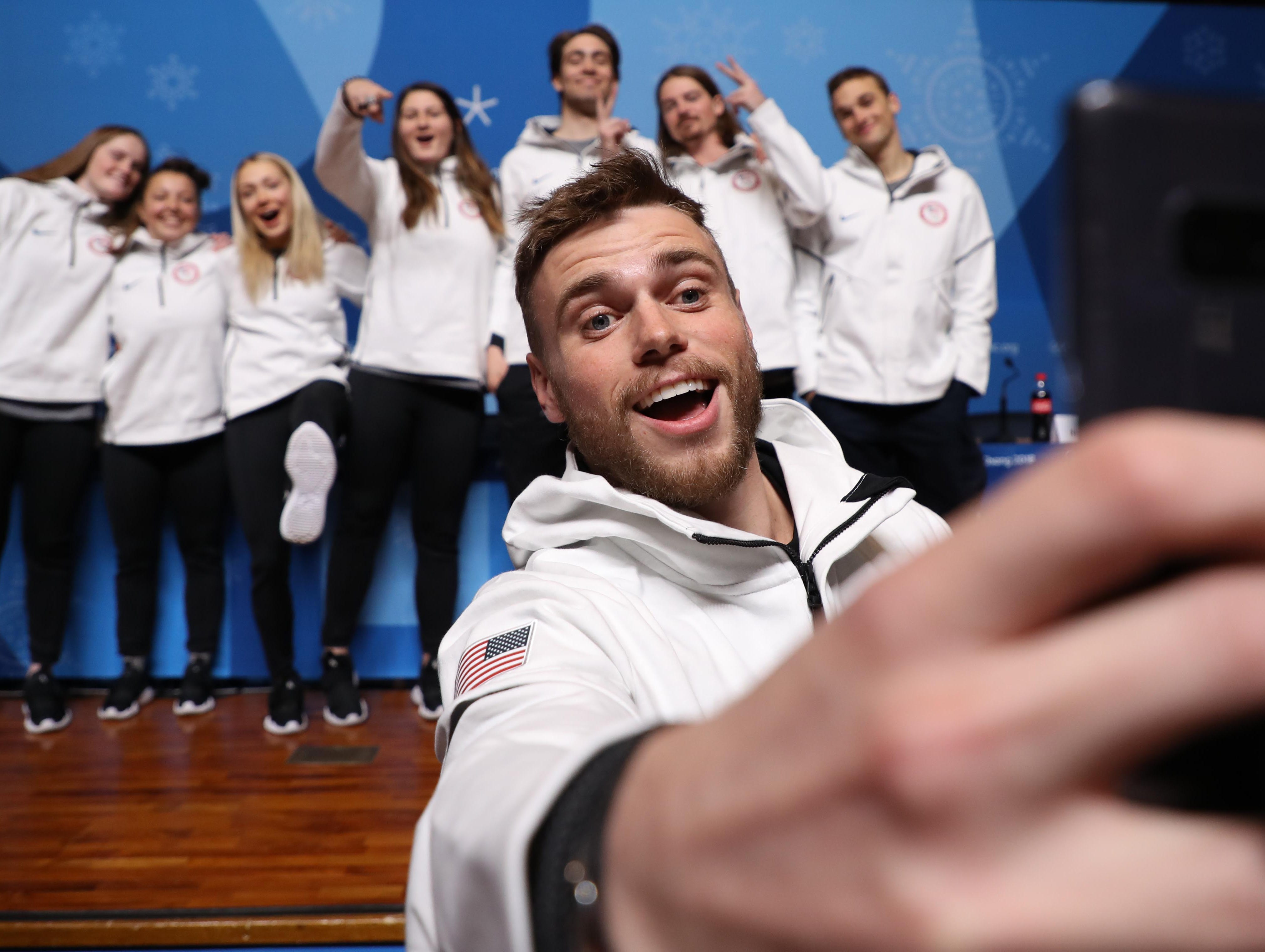 Feb. 11: Gus Kenworthy takes a selfie with his teammates during the slopestyle skiing press conference at the Pyeongchang Winter Games.