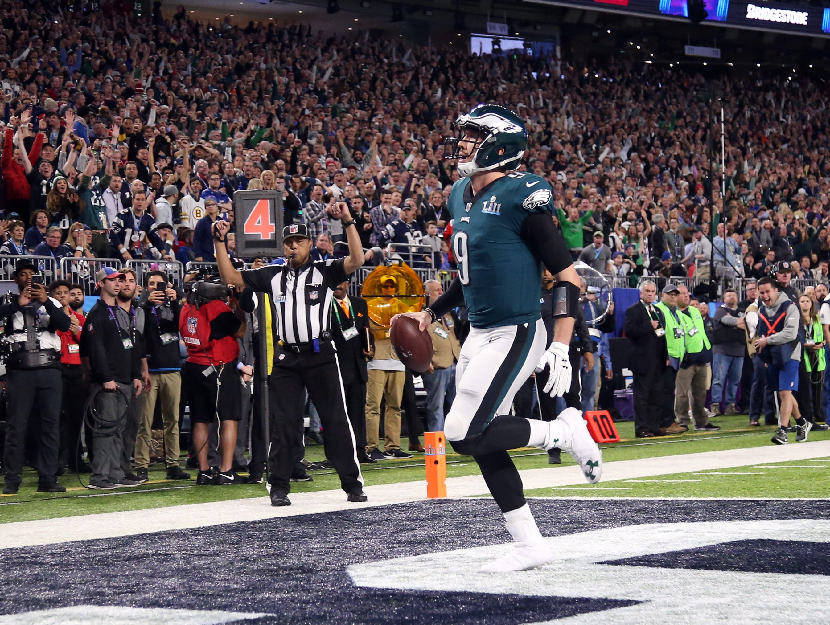"""Feb. 4: Philadelphia Eagles quarterback Nick Foles (9) catches the """"Philly Special"""" touchdown against the New England Patriots during the second quarter in Super Bowl LII at U.S. Bank Stadium."""