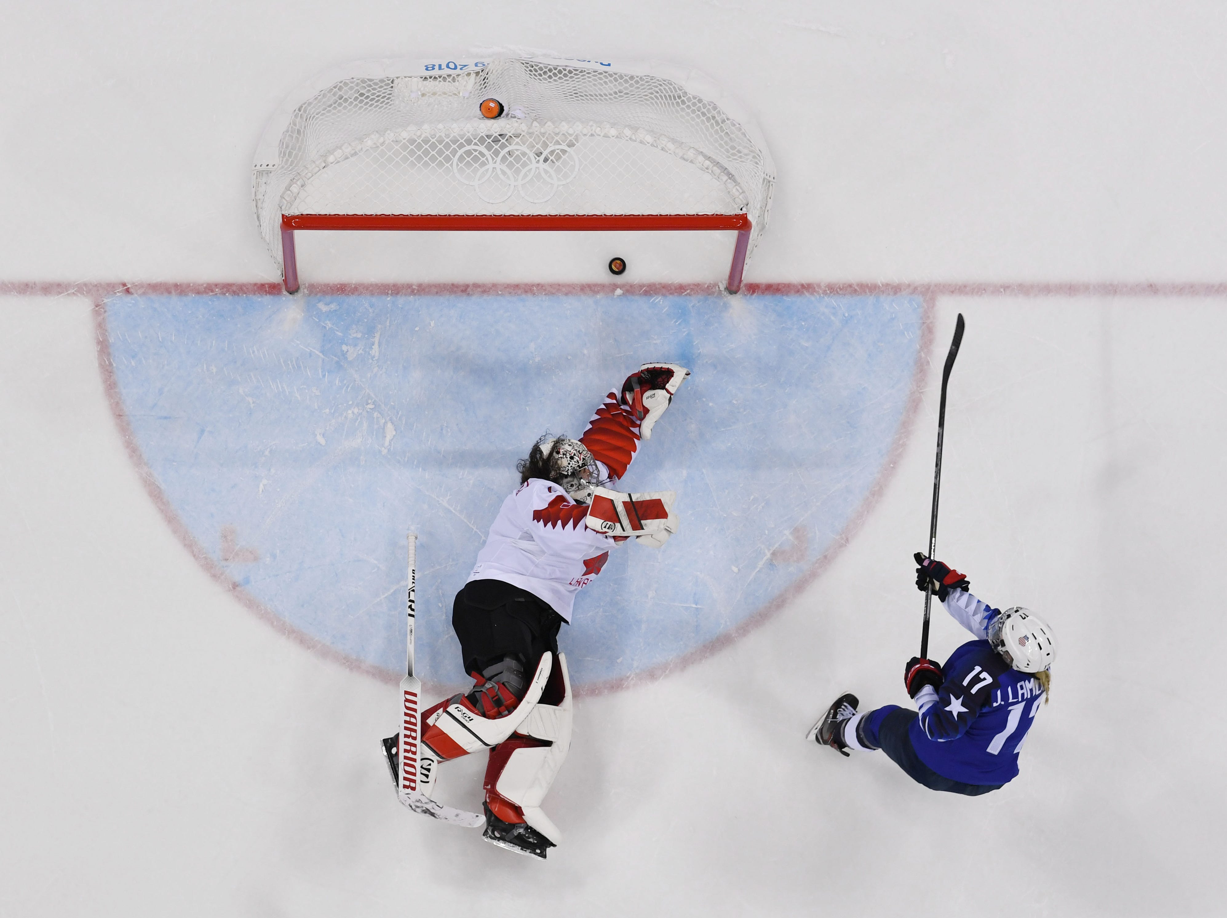 Feb. 22: United States forward Jocelyne Lamoureux (17) scores what would be the shootout winner past Canada goaltender Shannon Szabados (1) during the women's ice hockey gold medal game.