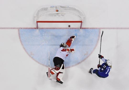 U.S. forward Jocelyne Lamoureux (17) scores the shootout winner past Canada goaltender Shannon Szabados (1) during the women's gold medal game.