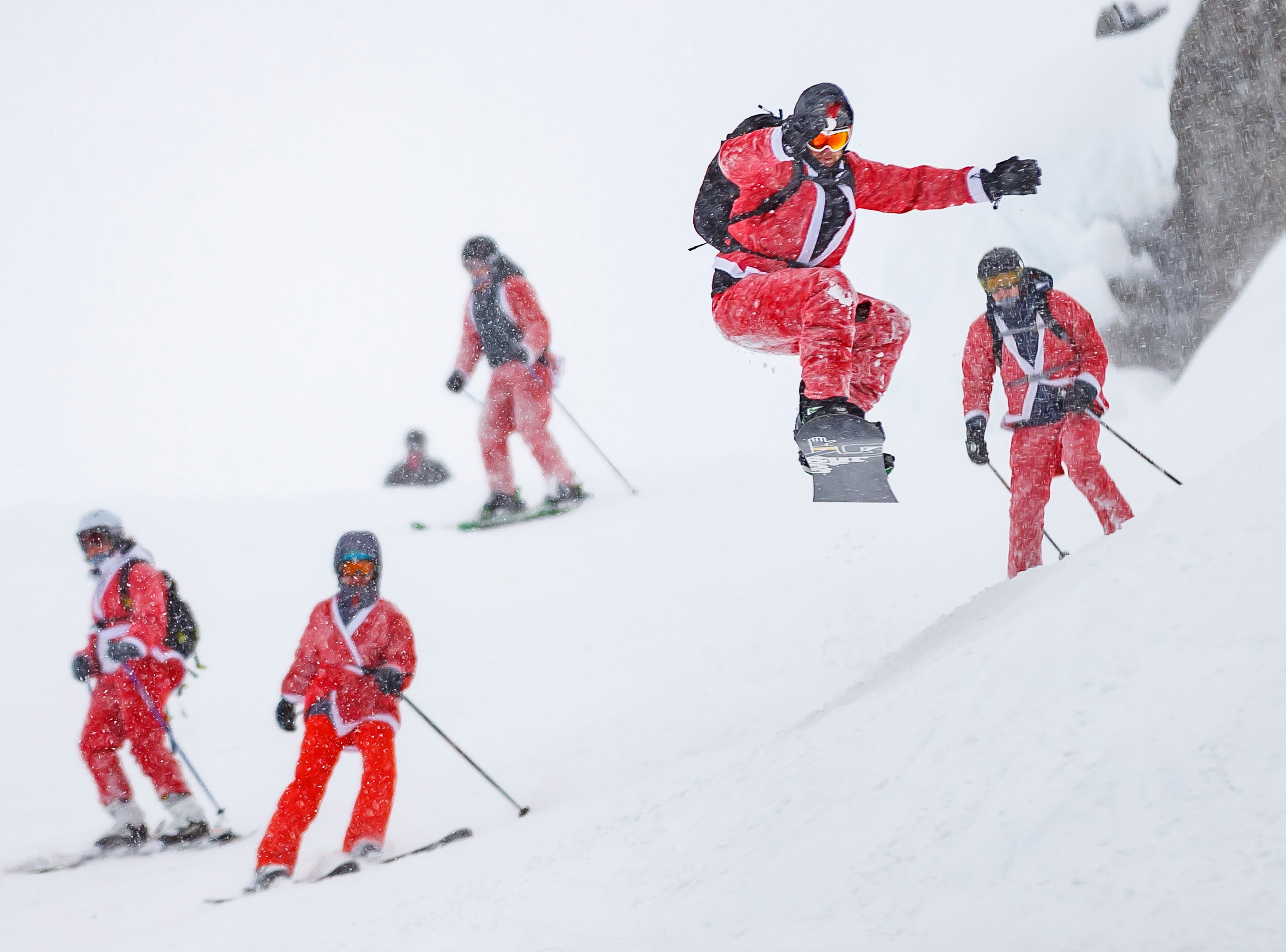 People dressed as Santa Claus enjoy the slopes of the alpine ski resort of Verbier, Switzerland on Dec. 8, 2018. 3015 skiers and snow boarders dressed as Santa Claus and Saint Nicholas were granted discounted 5 Swiss franc access pass to the ski resort as a promotional event to celebrate the opening of the ski season.