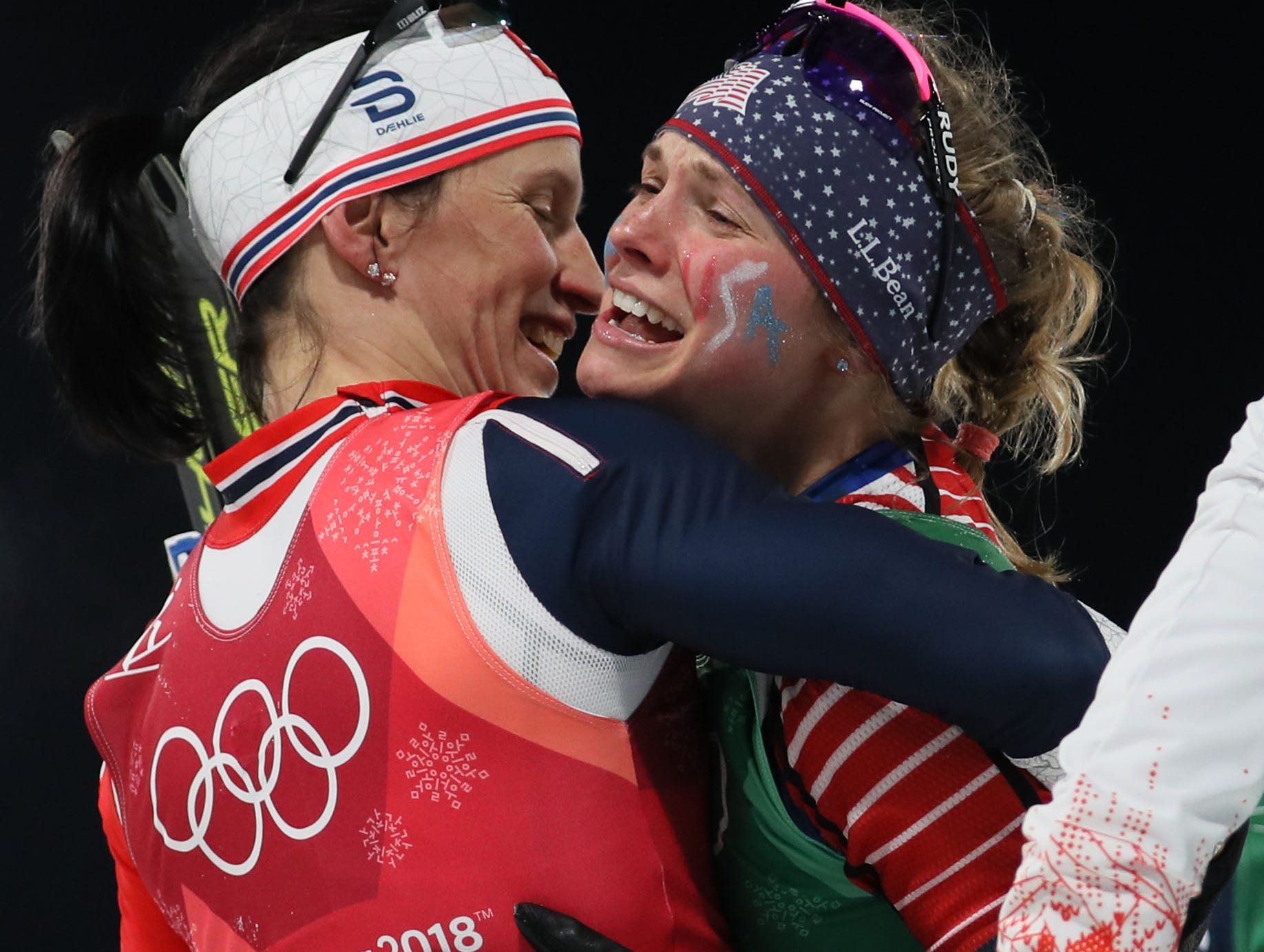 Feb. 21: Marit Bjoergen (NOR) congratulates Jessica Diggins (USA) after she and Kikkan Randall (USA) won the gold medal in the women's cross-country skiing team sprint freestyle during the Pyeongchang Winter Games.