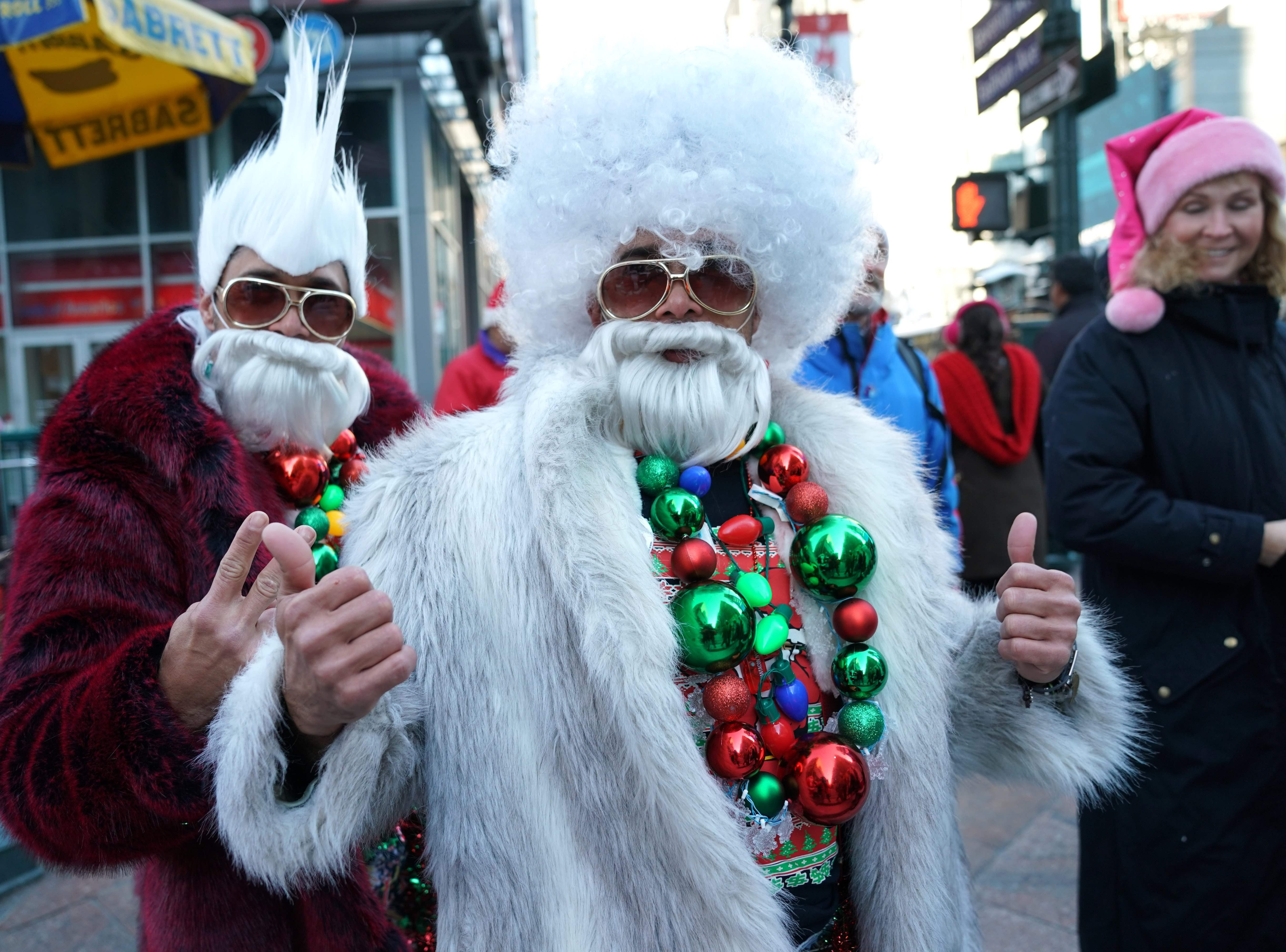 Revelers dressed as Santa Claus or in festive costumes  arrive for the start of SantaCon 2018 in New York  City Dec. 8, 2018. SantaCon the official Santa pub crawl happens in bars all across the world.
