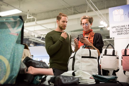 A display of items for sale by eco-friendly maker Rewilder at Unique Markets in Los Angeles, Calif. Rewilder creates backpacks from salvaged airbags and seat belts.