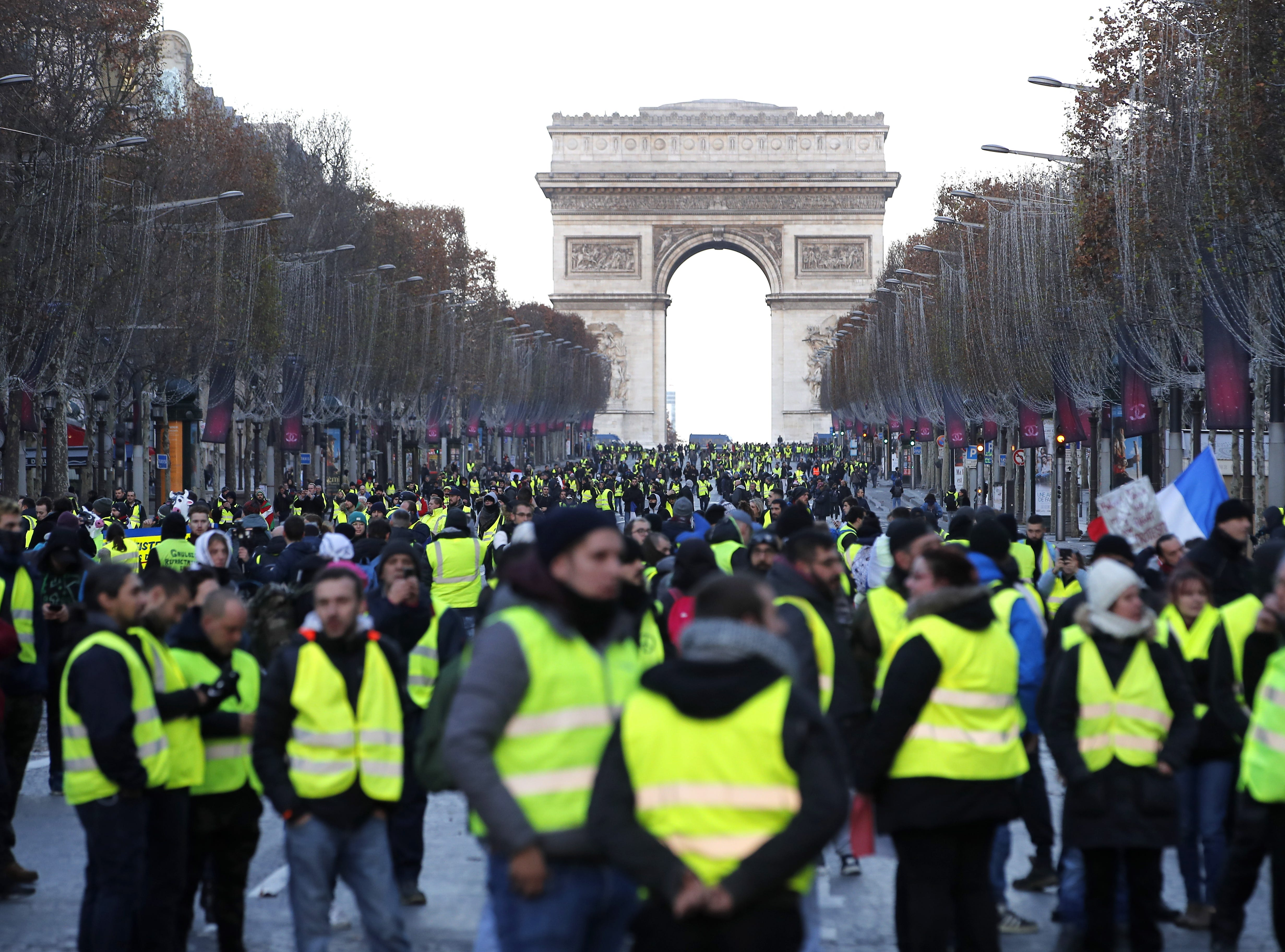 Yellow Vests protesters walk down the Champs Elysees avenue to Place de la Concorde during a demonstration in Paris, France on Dec.8, 2018. Police in Paris is preparing for another weekend of protests of the so-called 'gilets jaunes' (yellow vests) protest movement. Recent demonstrations of the movement, which reportedly has no political affiliation, had turned violent and caused authorities to close some landmark sites in Paris this weekend.  Seen in background is the landmark Arc de Triomphe.