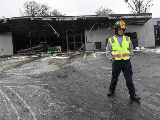 Anderson fire engineer John Urban looking over the remains of a fire at the Kezo Quick Stop convenience store on East Whitner Street Sunday morning, December 9, 2018.