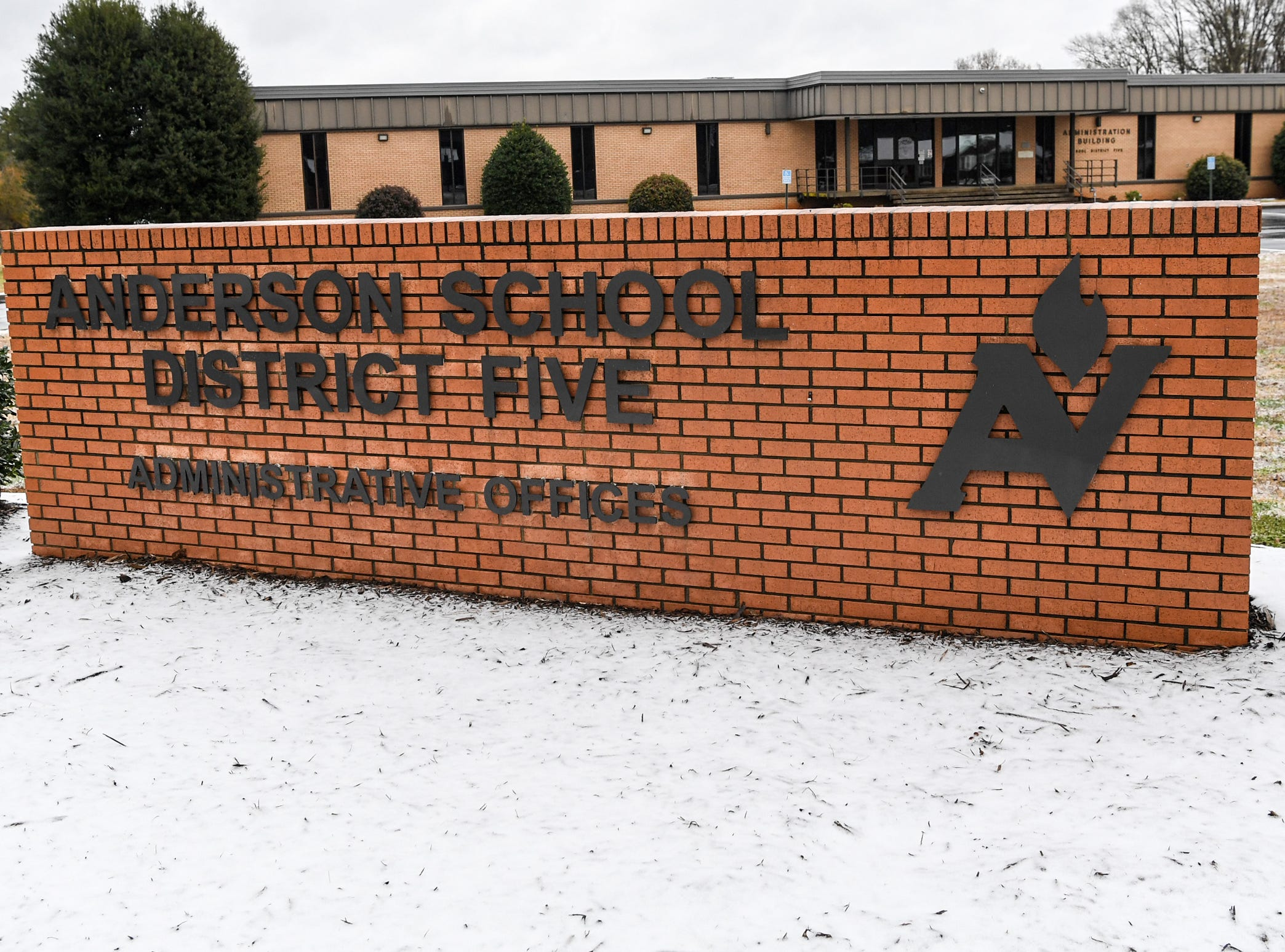 Snow and sleet fell around the sign for Anderson School District Five Administrative Offices along Highway 28 bypass in Anderson Sunday, December 9, 2018.