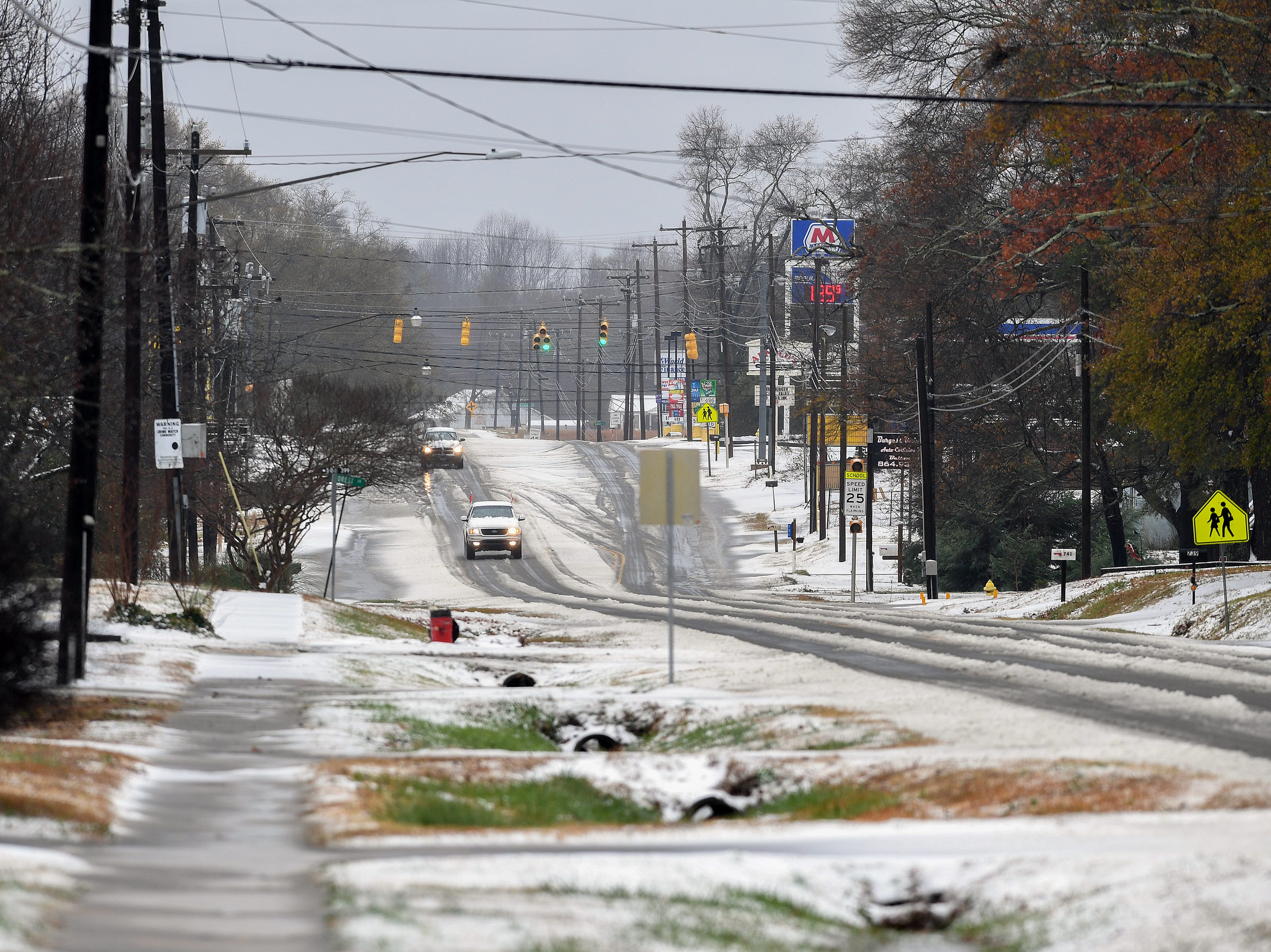 Sleet covers the street in Belton after a layer fell early Sunday December 9, 2018.