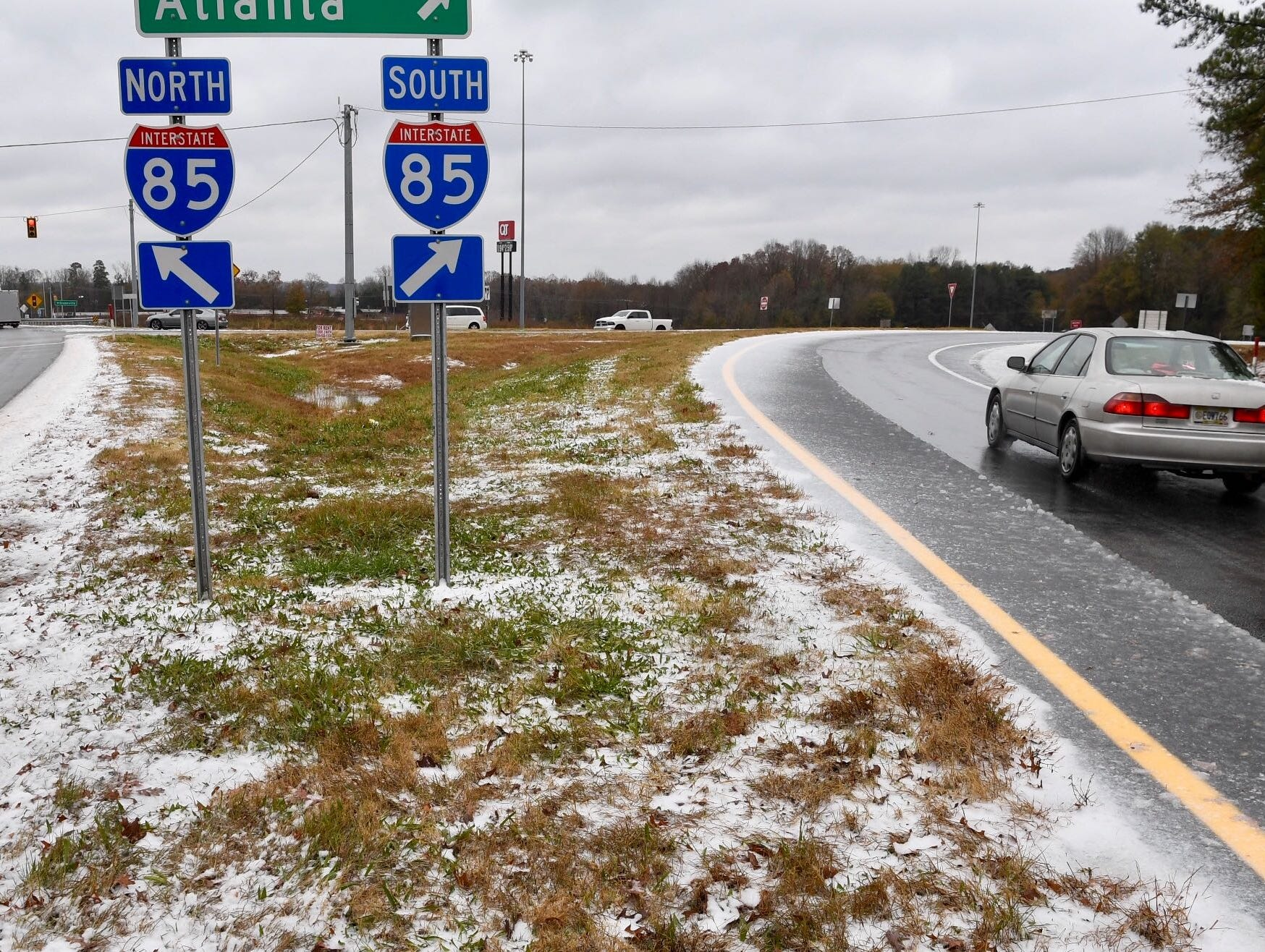 I-85 near Highway 178 (Liberty Highway) with traffic and SCDOT snowplows taking turns trading off scraping roads on Sunday, Dec. 9, 2018.