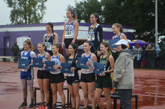 Grace Christian's Olivia Slayter (bottom row, second from right) finished fifth in the Class B girls race at the LHSAA state meet in Natchitoches.