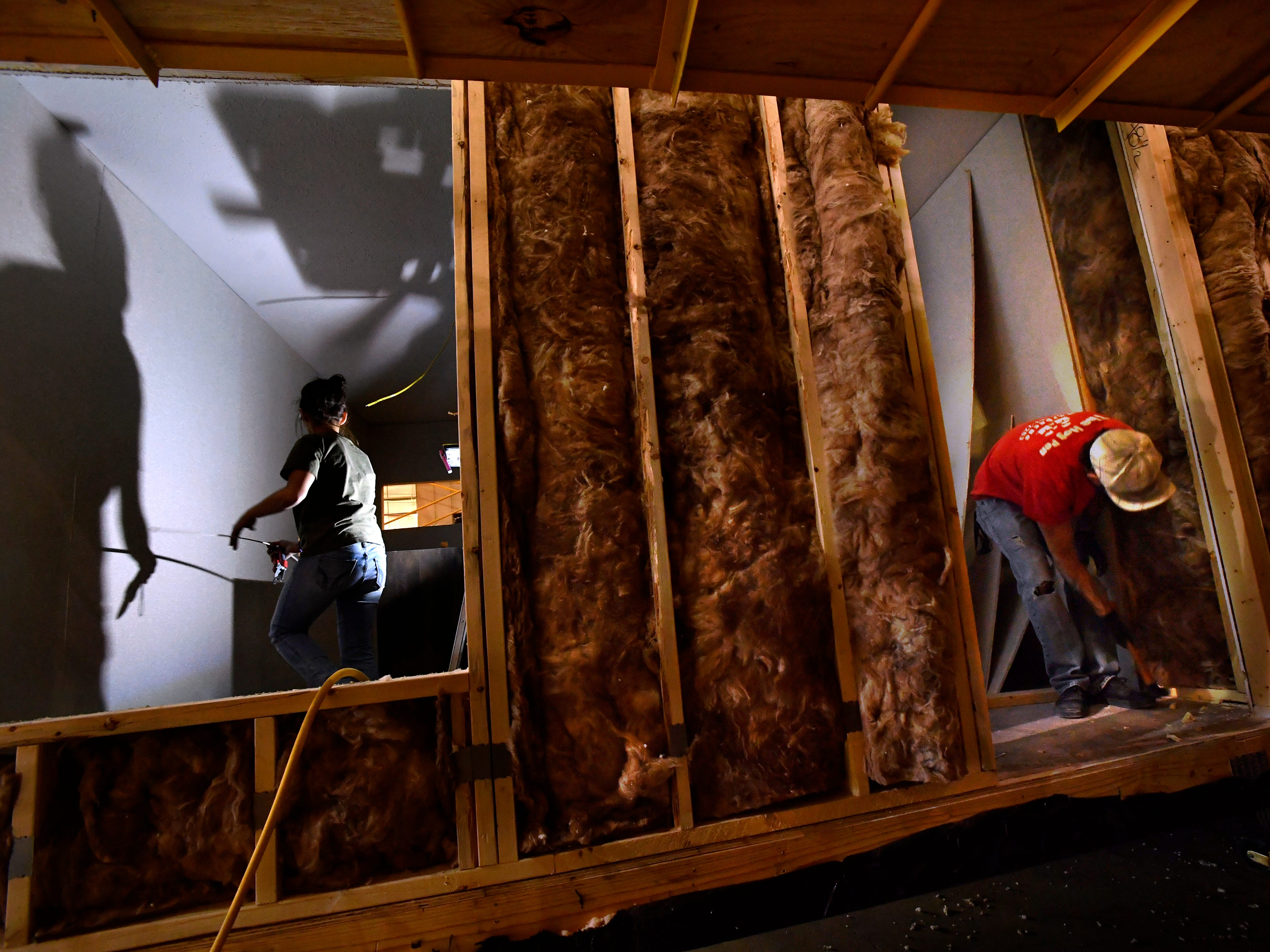 Ashley Gutierrez and Rickey Gonzales work on the interior of a six-bedroom modular building at New Vision Manufacturing in Breckenridge Nov. 28, 2018. Having started operations in October, the company has been on a hiring spree to train workers to fill their backlog of orders. They supply the units to oil field man camps in the Permian Basin.