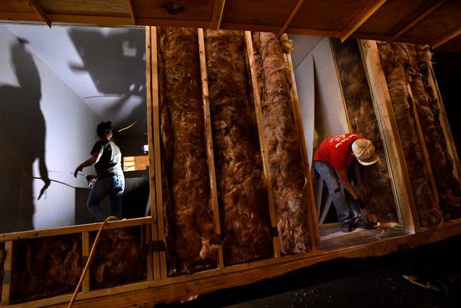 Ashley Gutierrez and Rickey Gonzales work on the interior of a six-bedroom modular building at New Vision Manufacturing in Breckenridge on Nov. 28.. Having started operations in October, the company has been on a hiring spree to train workers to fill their backlog of orders. They supply the units to oil field man camps in the Permian Basin.