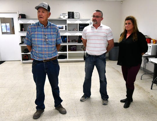 General manager Andy Nauert (left), production manager Bill Davidson and his wife, Stacy answer questions about New Vision Manufacturing during a tour of the Breckenridge plant Nov. 28.