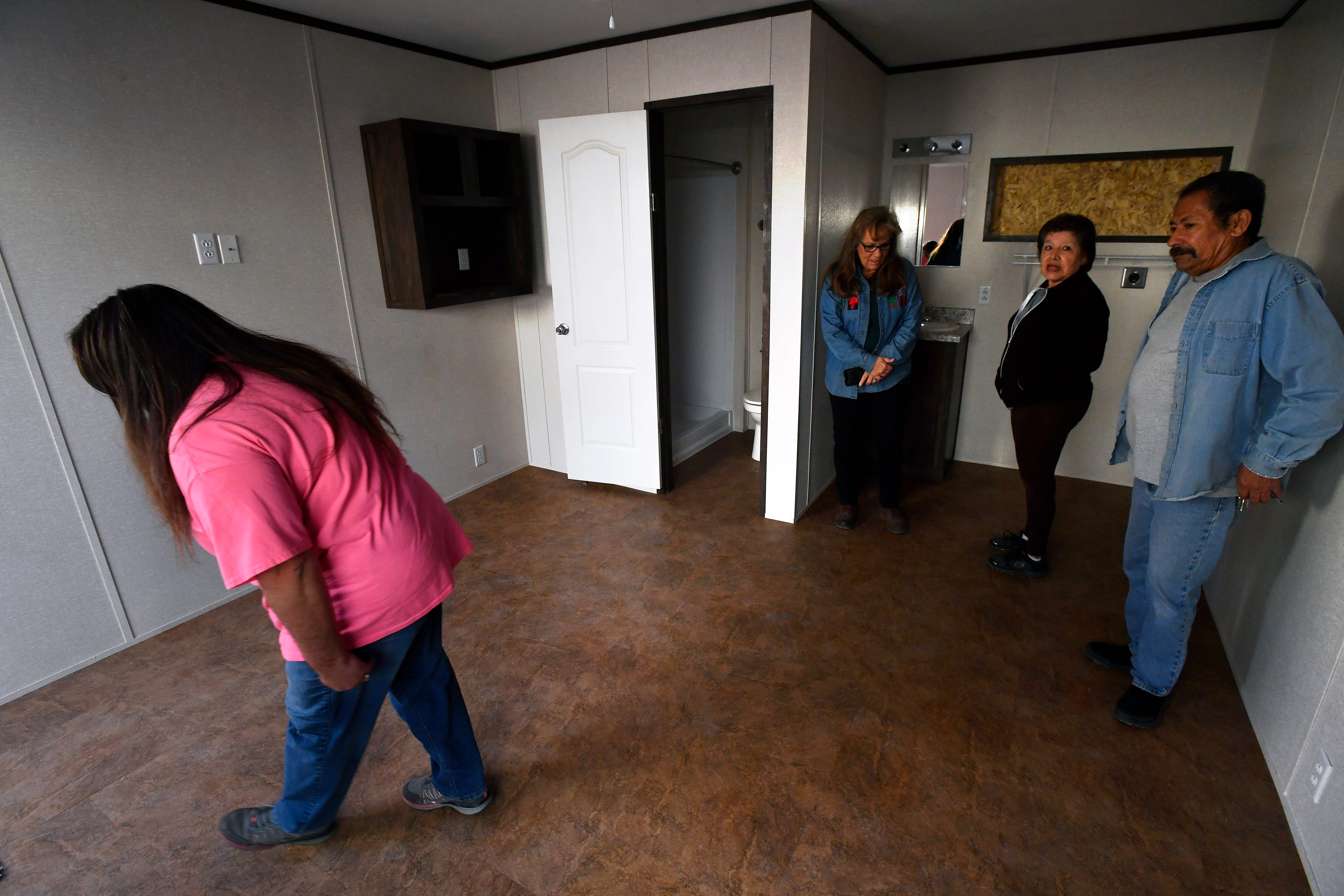 Visitors tour one of the completed units at New Vision Manufacturing in Breckenridge on Nov. 28.