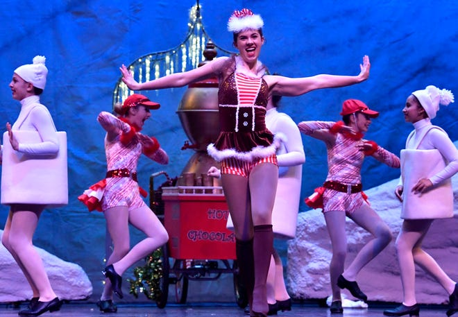 "In a segment about hot chocolate, Annalyn Shudde performs as the soloist during rehearsal Friday for ""Once Upon a Christmas Eve."" The show was performed by the Patty Harper Dance Studio this weekend at the Abilene Convention Center."