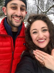 """Hey, check out this ice,"" Arun Rubenstein said to Elyse Kline on Sunday, while working on a snowman. The ""ice"" turned out to be the engagement ring Kline is showing off here."