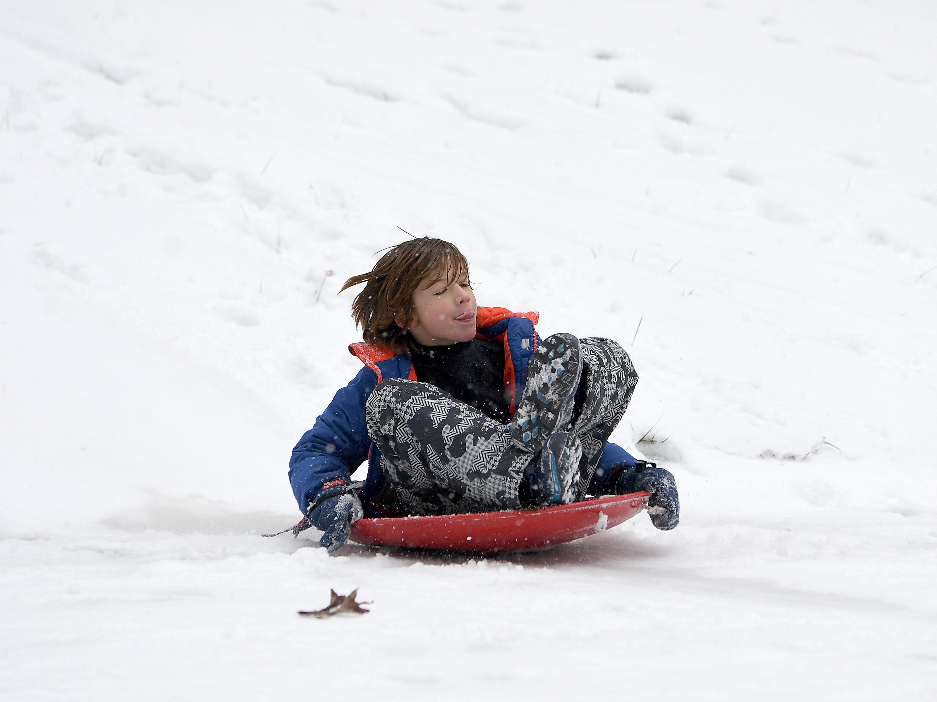 Dalton Howes, 8, sleds near his home in Haw Creek on Dec. 9, 2018.