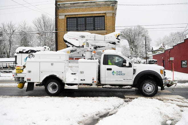 A Duke Energy truck is driven on Haywood Road in West Asheville Dec. 9, 2018.