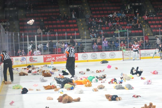 Fans at Floyd L. Maines Veterans Memorial shower the ice with stuff animals in the first period after what they thought was a goal by the Binghamton Devils on Teddy Bear Toss on Saturday night. Turns out, the goal was waved off by a penalty.