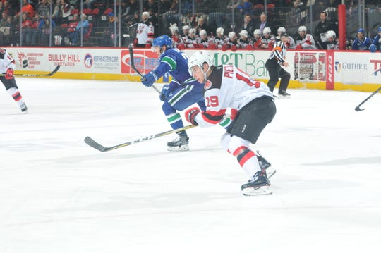 The Binghamton Devils' Blake Pietila pursues the play against the Utica Comets on Saturday night at Floyd L. Maines Veterans Memorial Arena.