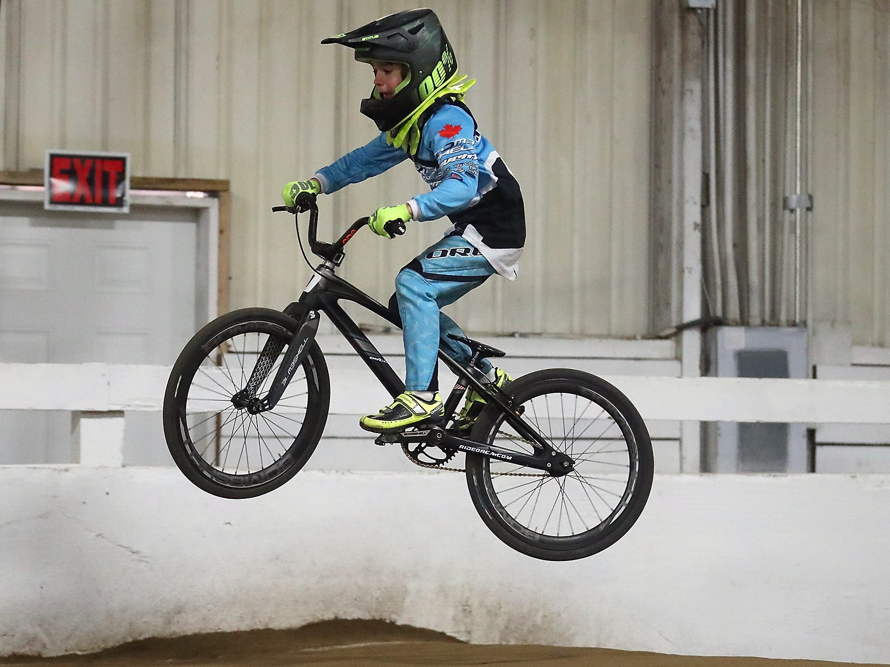 Wyatt Christensen, 6, of Kingston, rides the track at Peninsula Indoor BMX in Port Orchard on Saturday, December 8, 2018. Christensen won a national championship for his age group at the USA Grand National Championship races in Tulsa in November, and next year he'll compete at the UCI World Championships in Belgium.