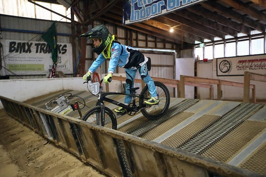 Wyatt Christensen waits for the starting gate to open at Peninsula Indoor BMX in Port Orchard on Dec. 8. The national champion in the sport for his age group, Wyatt has his sites set on the 2028 or 2032 Olympics.