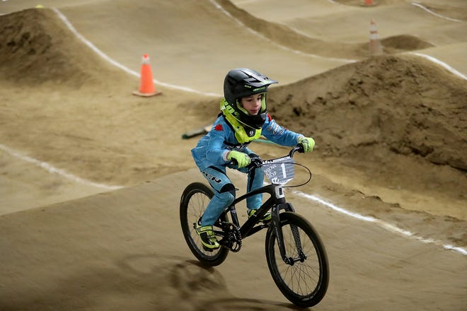 Wyatt Christensen, 6, of Kingston, rides at Peninsula Indoor BMX in Port Orchard on Dec. 8. Christensen won a national championship for his age group at the USA Grand National Championship races in Tulsa, Oklahoma, in November, and next year he'll compete at the UCI World Championships in Belgium.