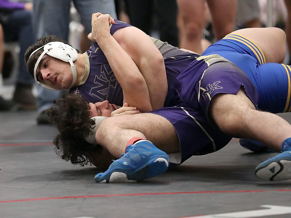 North Kitsap's Nouh Hammou pins Bremerton's Henry Buentello during their 220-pound bout at the Olympic Duals on Saturday, December 8, 2018.