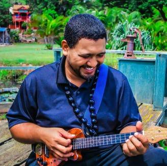 Hawaiian music artist Kuhio Travis makes one of his regular stops at the Treehouse Cafe on Bainbridge Island Dec. 14.