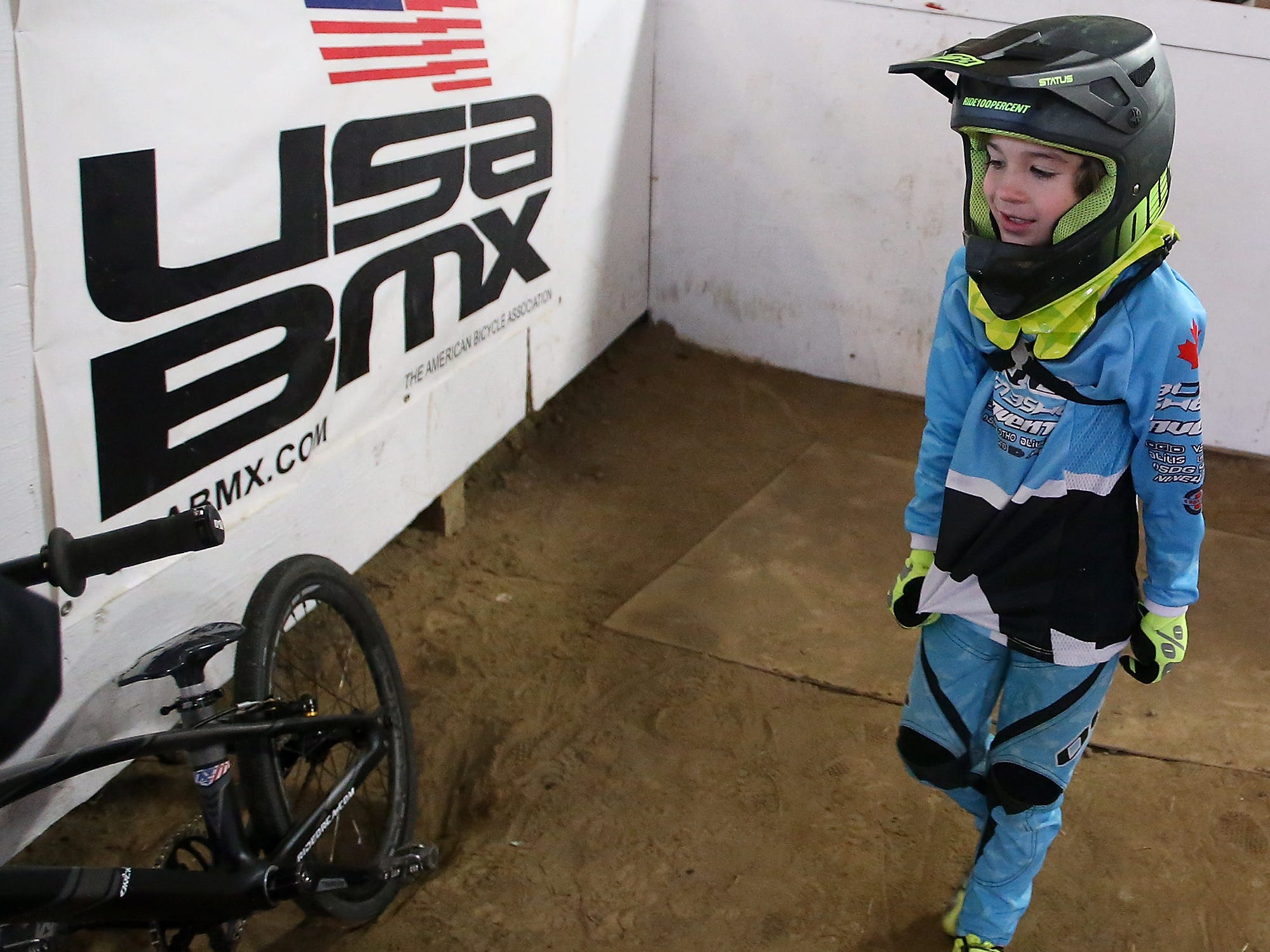 Wyatt Christensen, 6, of Kingston, gets ready to jump on a bike to ride the track at Peninsula Indoor BMX in Port Orchard on Saturday, December 8, 2018.