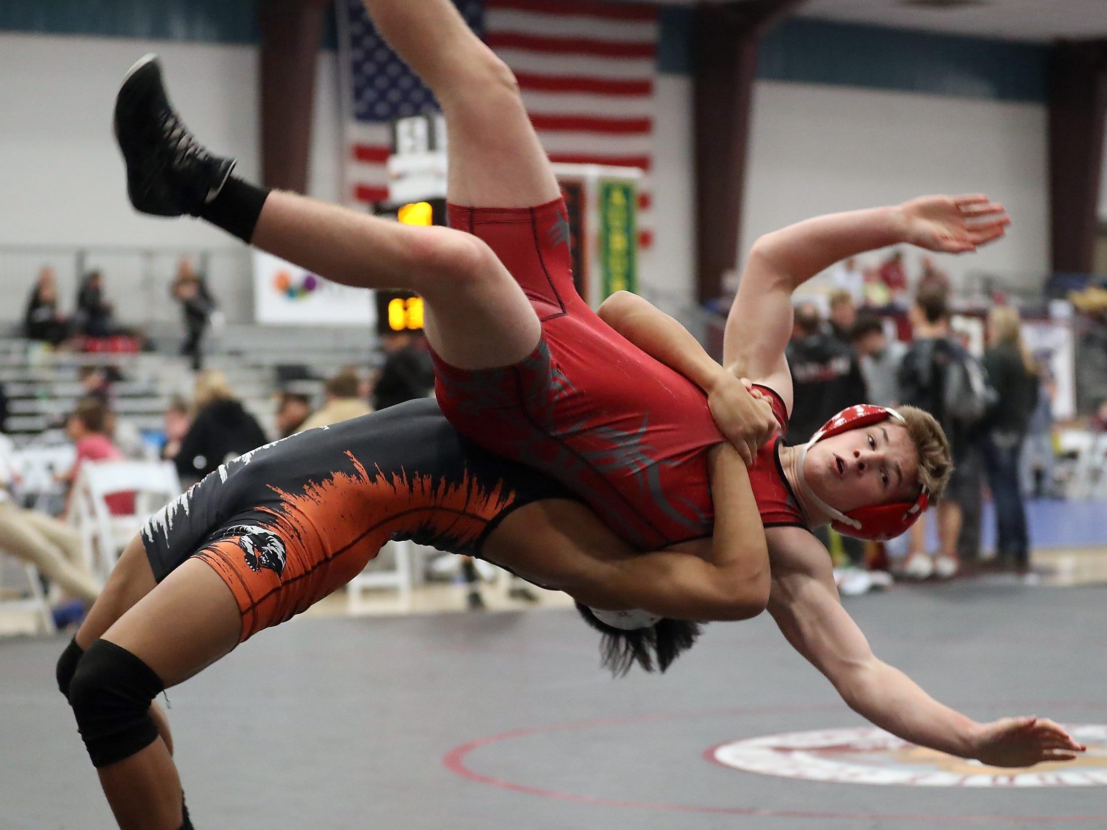 Central Kitsap's Shayne Hew-Len flips Mount Si's Braedon Haynie during their 132-pound bout Olympic Duals at the Kitsap Sun Pavilion in Silverdale on Saturday, December 8, 2018.