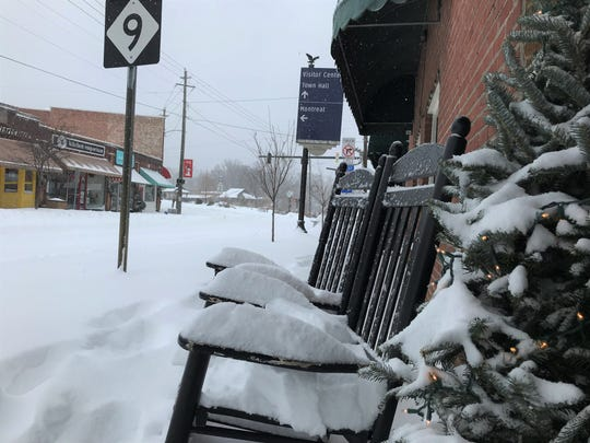 Snow piles up on rocking chairs along State Street in Black Mountain on Dec. 9.