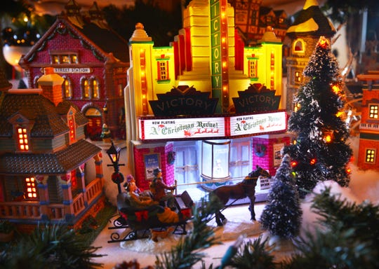 Nancy Campanaro spends days setting up her Christmas village tree adorned with Lemax, Mr. Chrismas and other brands of Christmas villages.