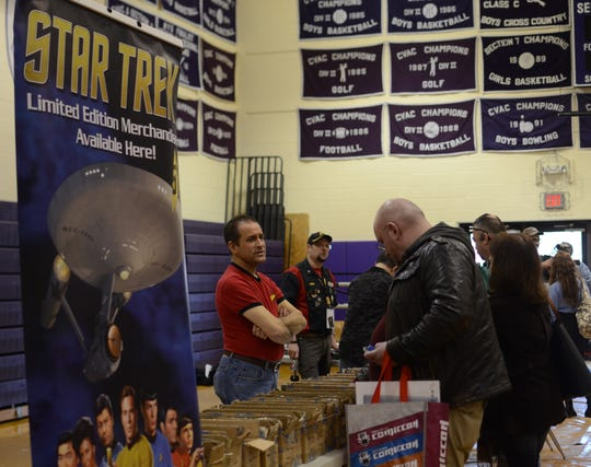 Star Trek fans look through merchandise at Ticonderoga High School, Dec. 8, 2018.
