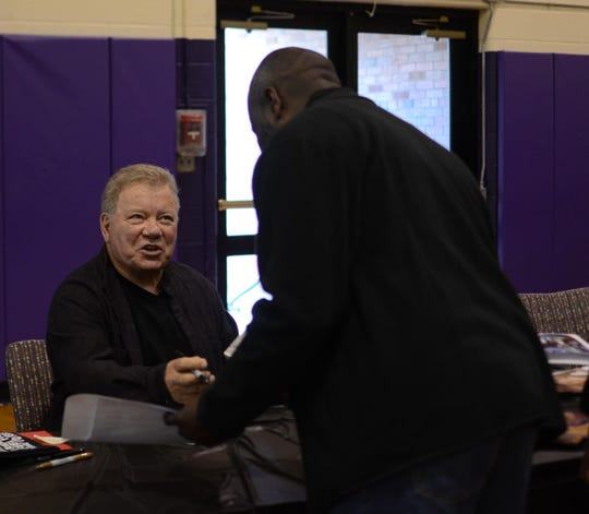 William Shatner, who portrayed Captain Kirk in Star Trek, greets fans at Ticonderoga High School, Dec. 8, 2018.