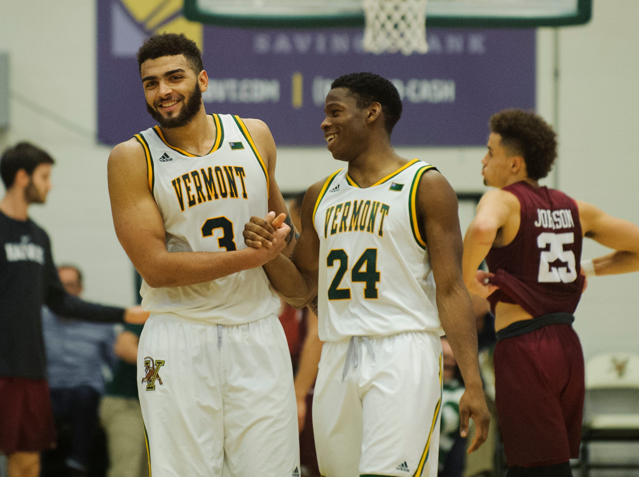 Vermont guard Ben Shungu (24) and Vermont forward Anthony Lamb (3) celebrate at the conclusion of the men's basketball between the Harvard Crimson and the Vermont Catamounts at Patrick Gym on Saturday night December 8, 2018 in Burlington.