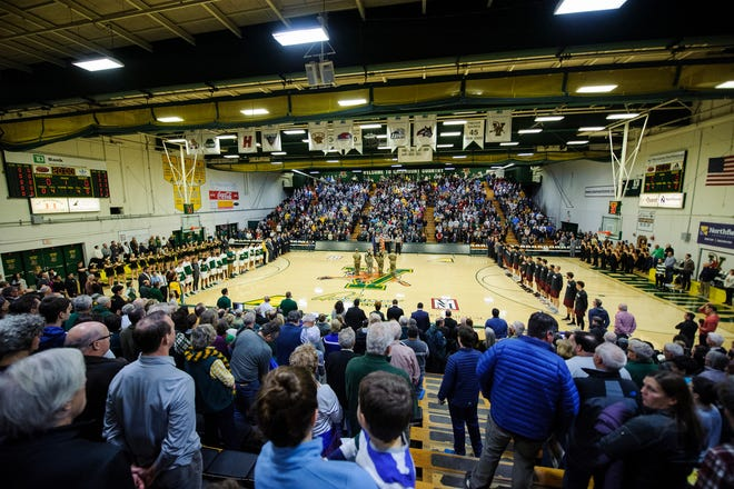 The teams listen to the Nation Anthem during the men's basketball between the Harvard Crimson and the Vermont Catamounts at Patrick Gym on Saturday night December 8, 2018 in Burlington.