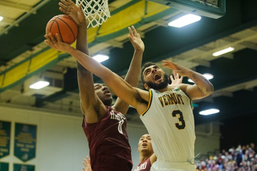 16ce38fe64ad Vermont forward Anthony Lamb (3) leaps for a lay up past Harvard s Chris  Lewis