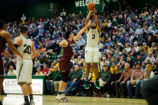 Vermont forward Anthony Lamb (3) shoots a three pointer over Harvard's Danilo Djuricic (30) during the men's basketball between the Harvard Crimson and the Vermont Catamounts at Patrick Gym on Saturday night December 8, 2018 in Burlington.