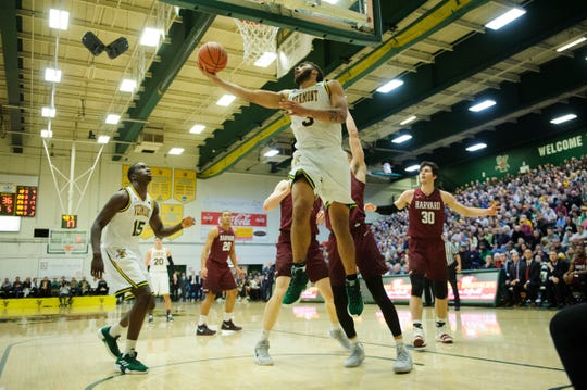 Vermont forward Anthony Lamb (3) leaps for a lay up during the men's basketball between the Harvard Crimson and the Vermont Catamounts at Patrick Gym on Saturday night December 8, 2018 in Burlington.