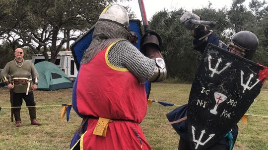 Two medieval knights fight in a duel at the 20th annual Ingleside Renaissance Faire Saturday, Dec. 8, 2018.