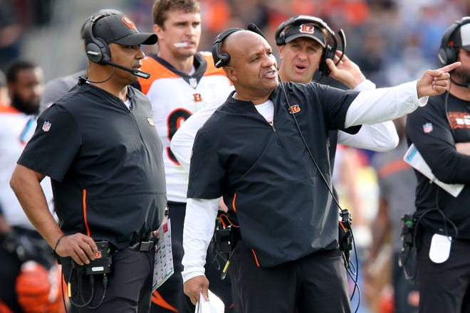 Cincinnati Bengals special assistant to the head coach Hue Jackson, right, points something out to Cincinnati Bengals head coach Marvin Lewis in the second quarter of a Week 14 NFL football game against the Los Angeles Chargers, Sunday, Dec. 9, 2018, at StubHub Center in Carson, California.