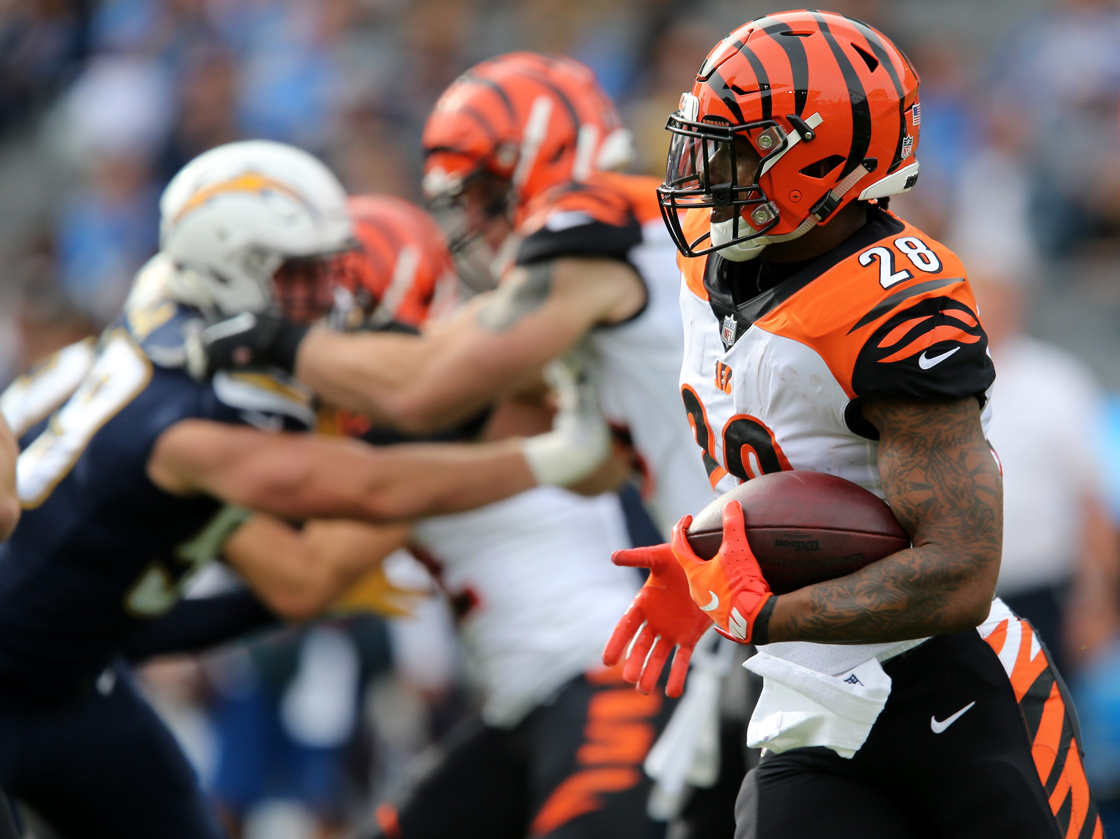 Cincinnati Bengals running back Joe Mixon (28) carries the ball in the first quarter of a Week 14 NFL football game against the Los Angeles Chargers , Sunday, Dec. 9, 2018, at StubHub Center in Carson, California.