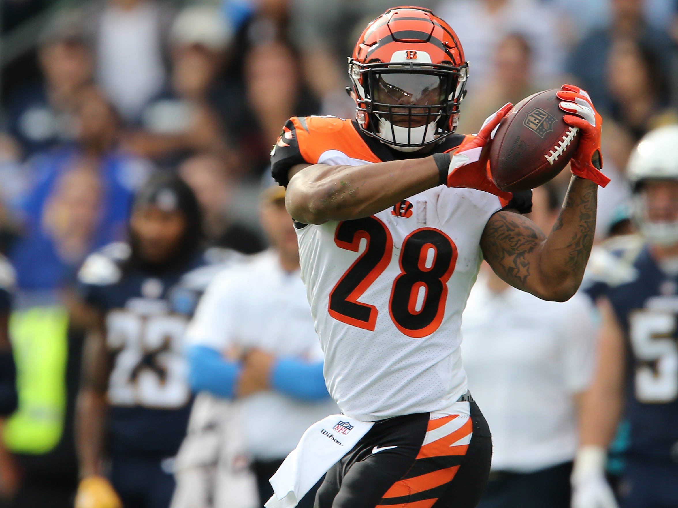 Cincinnati Bengals running back Joe Mixon (28) catches a pass in the first quarter of a Week 14 NFL football game against the Los Angeles Chargers, Sunday, Dec. 9, 2018, at StubHub Center in Carson, California.