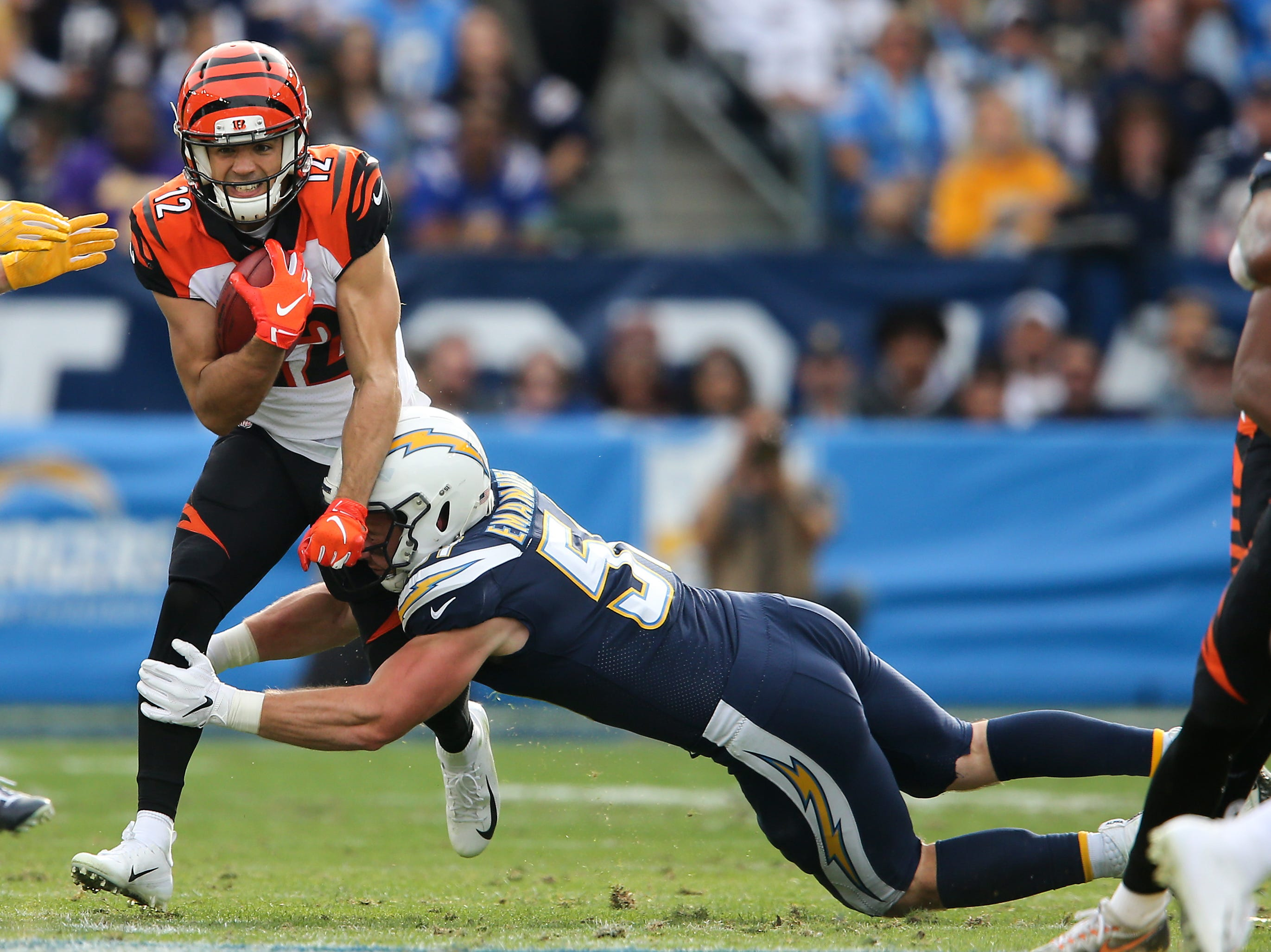 Cincinnati Bengals wide receiver Alex Erickson (12) returns a punt in the second quarter of a Week 14 NFL football game against the Los Angeles Chargers, Sunday, Dec. 9, 2018, at StubHub Center in Carson, California.