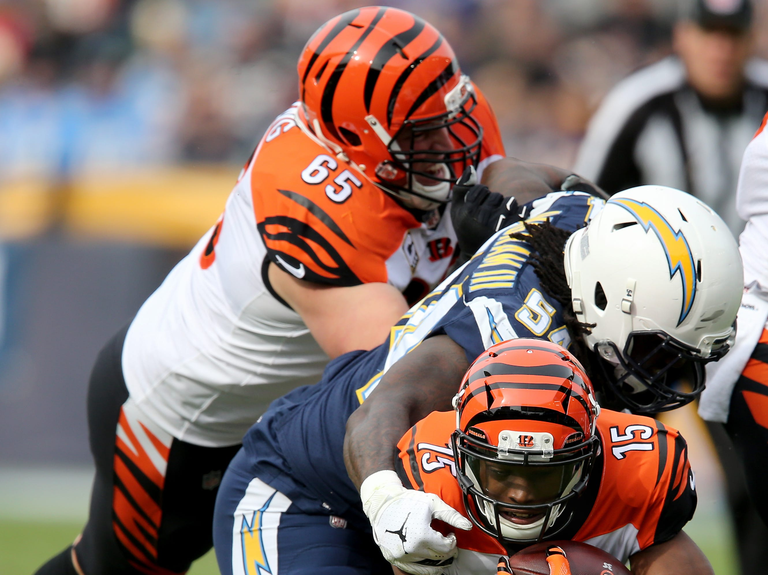 Cincinnati Bengals wide receiver John Ross (15) dives for the end zone in the first quarter of a Week 14 NFL football game against the Los Angeles Chargers, Sunday, Dec. 9, 2018, at StubHub Center in Carson, California.