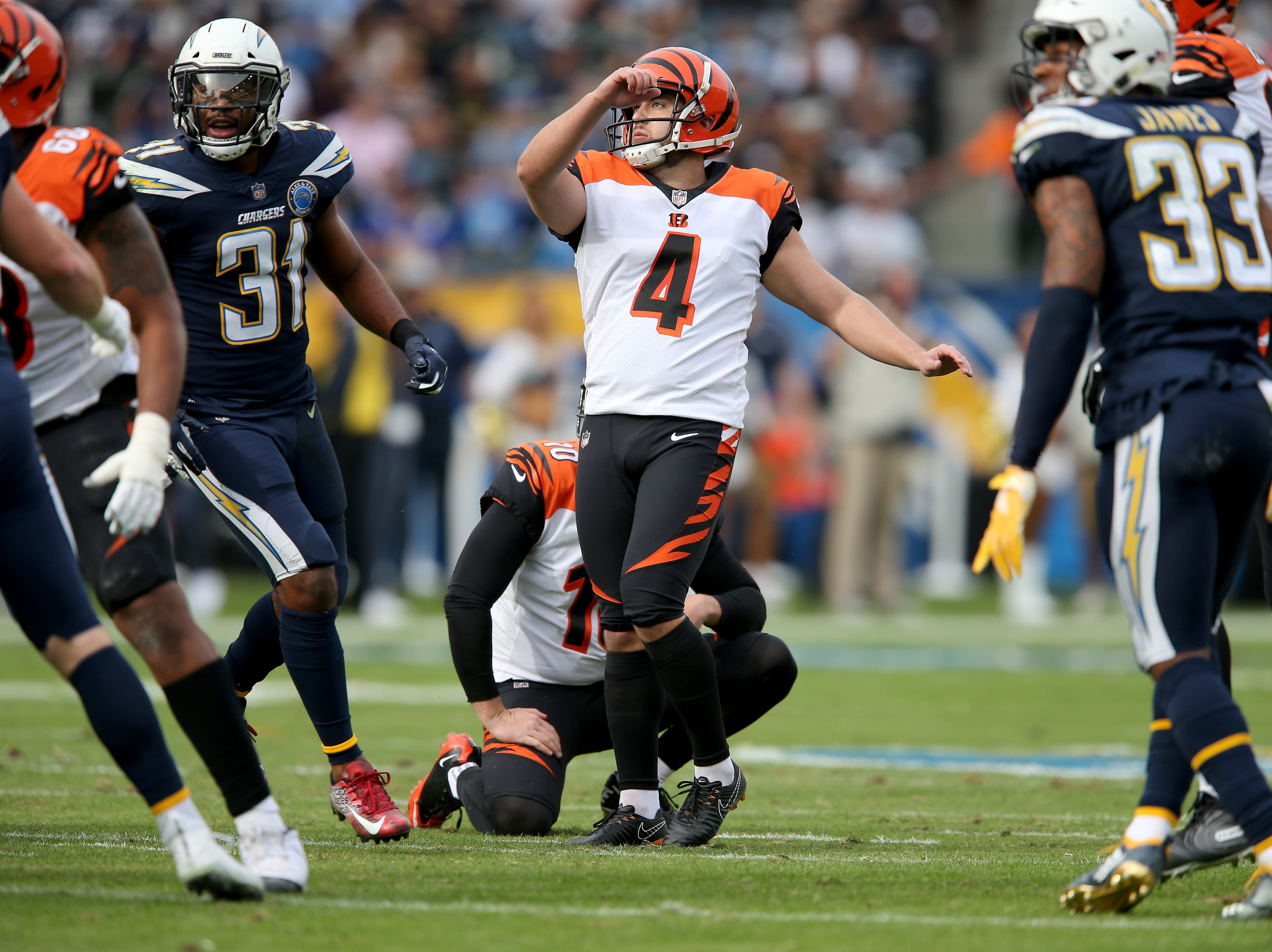 Cincinnati Bengals kicker Randy Bullock (4) kicks a field goal in the first quarter of a Week 14 NFL football game against the Los Angeles Chargers, Sunday, Dec. 9, 2018, at StubHub Center in Carson, California.